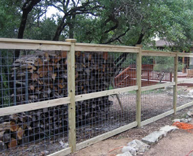 Cattle panels with wood frames making a solid ranch cattle fencing